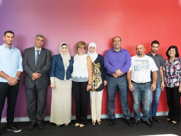 Elfa Moraitakis and SydWest caseworker, Mervat Altarazi with the newly elected committee, Syrian Community Association